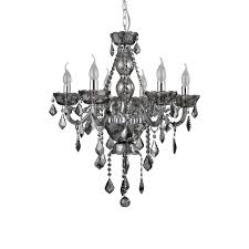 two carved cognac glass spindles encase the chandelier s iron pipe while a silver iron link chain suspends it from the ceiling