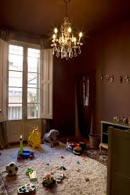 Image above: A dark brown wall color with an elegant chandelier makes this  nursery relaxing for both adults and children. See all the photos of this  ...