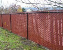 add color to a chain link fence with red privacy slats