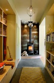stunning and luxurious corner wood burning stove design in hallway with storage and runner rug with