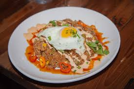 topped with fried egg one of the popular dishes at southern social kitchen and bar in vero beach is the southern ramen which brings some sweet heat to the
