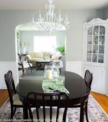 traditional dining room with white chandelier and dark table white dining room chandelier