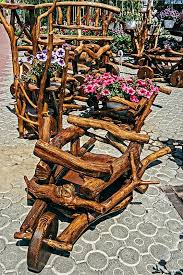 furniture made from tree trunks. garden furniture made of branches and tree trunks finished varnished stock photo from