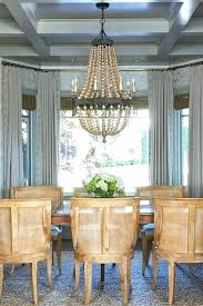 chandeliers wooden bead chandelier wood a beads hangs from gray ceiling above an antique dining