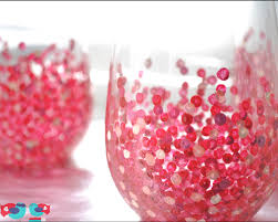 hand painted stemless wine glasses with red dots using enamel paint and baking in the oven