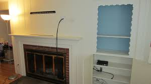 cute tv mount for fireplace about wall over