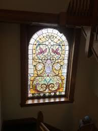 photo original stained glass window on the staircase