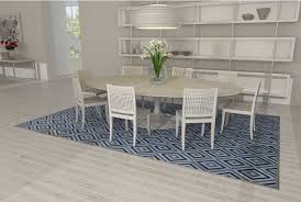 patchwork cow rug in grey and blue diamonds in a bright dining room with a tulip