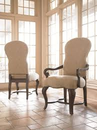 sloping arm dining chair high back upholstered room with wooden arms on ceramic floor tile together