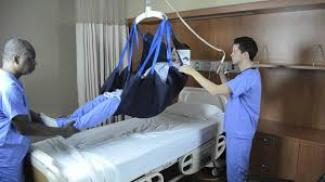 transfer from bed to wheelchair using repositioning sling and ceiling lift
