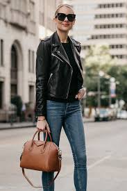 blonde woman wearing black leather jacket denim skinny jeans givencny antigona cognac satchel fashion jackson dallas