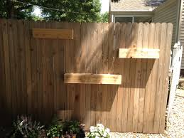 unfinished diy fence mounted garden planter boxes in the side yard house ideas