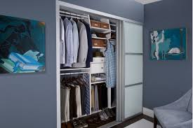 reach in closet white and silver sliding doors dark blue paint on walls artwork on wall