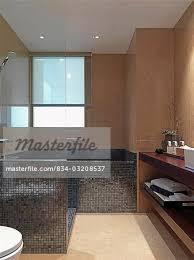 mosaic tile bathtub and shower stock photo