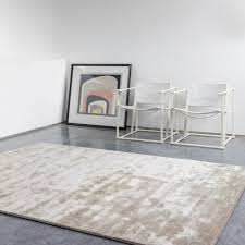 uni reflect rugs    in taupe by ligne pure  free uk
