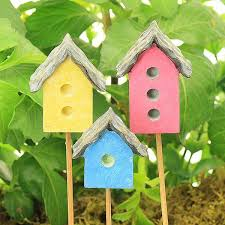 colourful bird house pink yellow blue