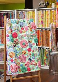 Best 25+ Quilt shops ideas on Pinterest | Fabric for sale online ... & I really like this version of a yo-yo quilt. Sunny Texas Quilt Shop Adamdwight.com