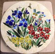 this 36 round mosaic table top was created for our client in arizona the pattern is a colorful fl motif with a hummingbird and dragonfly