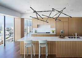 contemporary kitchen island lighting. stick unique kitchen island lighting above white quartz countertop light brown wooden cabinet two contemporary