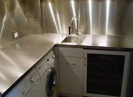 stainless steel countertop and backsplash in laundry room