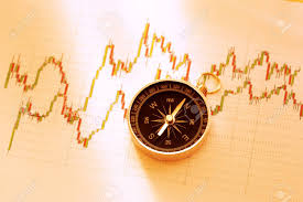 Compass On Stock Market Data Chart In Closeup