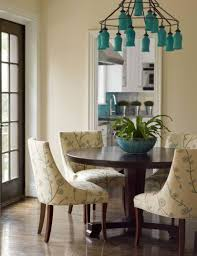 orb upholstered dining chair turquoise blue glass chandelier round dining table yellow and blue uph