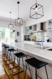 best kitchen layouts designs with black pendant lights