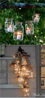 you can add some mason jar wire handles to create enchanting lanterns make them easily using clothes hangers in this hanging mason jar lanterns tutorial