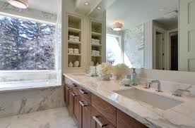 view in gallery bathroom with built in wall shelves