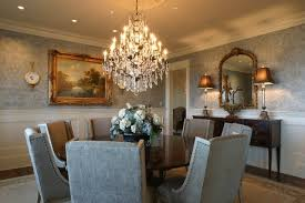 elegant furniture and lighting. Elegant Dining Room With Parsons Chairs And Round Table Under The Grandeur Crystal Chandelier : Furniture Lighting