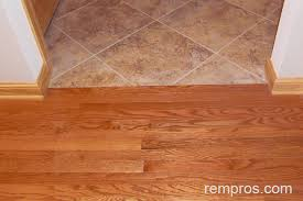 solid prefinished hardwood floor in transition with porcelain tile