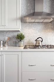 mother-of-pearl penny tile backsplash will reflect the light