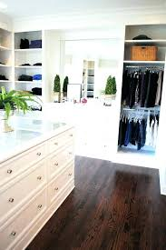 master closet island ideas furniture with drawers walk in a glass globe pendant hangs over mirrored top cl