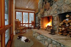 fireplace wood holder porch rustic with bead board ceiling braided rug cabin dog fireplace flagstone