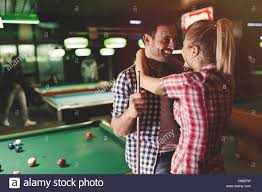 Couple having fun on pool table