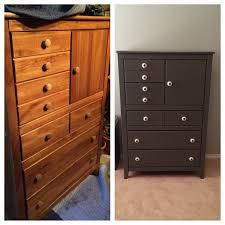 her finished gray dresser is another example of how far a coat of paint and new knobs can go in reviving a piece of furniture that would otherwise go
