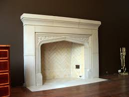 classic white cast stone fireplace on black wall and small wooden drawer