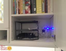 use a three tiered corner shelf to create a diy charging station for your electronics that