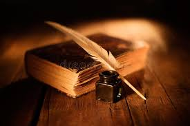 old book with quill pen and inkwell on wooden table stock photo image of