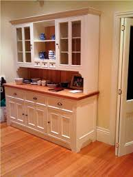 Hutch Furniture Piece In The Kitchen With White Color And Glass