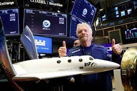 Billionaire Branson flies with own ...