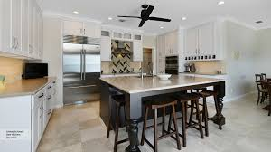 pearl white shaker cabinets in a casual kitchen