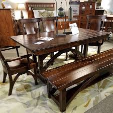 in view of the b o railroad trestle table set with bench arm chairs and side chairs made in solid character cherry in old world distressing