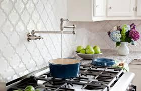 antique kitchen style ideas with white beveled arabesque tile backsplash swivel spout drinking water tap