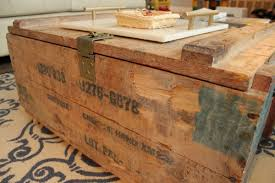 unfinished grenade boxes used like coffee tables