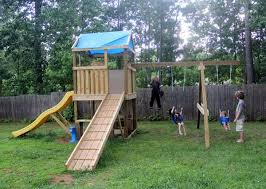 this swing set has a lot of things on it that most kids would love it includes swings a slide and a cool ramp to run up to get to the slide