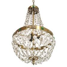 three light chandelier with chains of swarovski crystal and green hard stone embedded in the