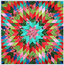 Jan Krentz Blog » Quick Star Quilts book & Hollyhock Garden Starburst Quilt by Jan Krentz Adamdwight.com