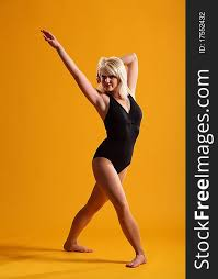 dramatic dance pose by blonde woman
