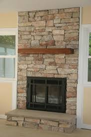 covering a gas fireplace with stone to make it look real